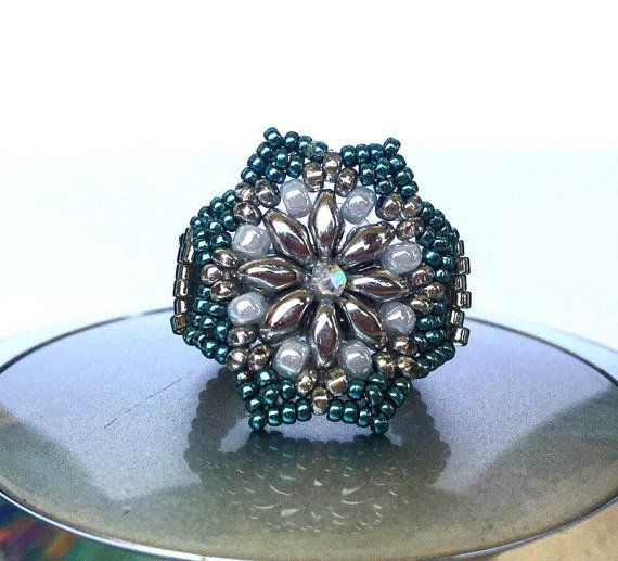 It is very tender and elegant ring made in peyote technic , has a beaded flower in front and silver warp. I used high-quality Czech and Japan seed beads. I can customize it to your size.