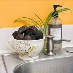 DIY Coffee Grounds Garbage Disposal Cleaners: Instead of tossing your coffee grounds in the trash, give them new life and DIY these helpful garbage disposal cleaners that leave your sink smelling amazing — especially if you're a coffee-lover!