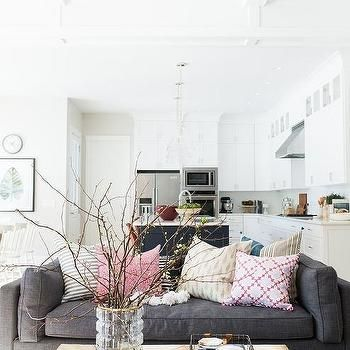 Dark Gray Sofa with Pink and Gray Pillows