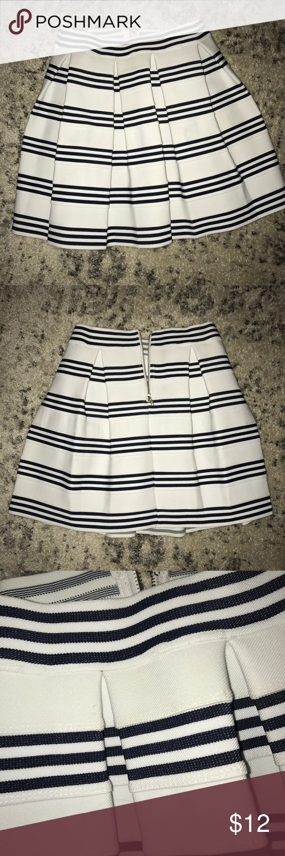 White and Navy Striped Skirt Super cute navy and white striped skirt! Fabric is thick and stiffer material so it holds its structure when wearing. Only worn a couple of times. Francesca's Collections Skirts
