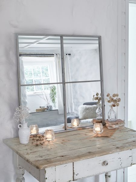 Made from distressed antique silver metal, this loft style window mirror has 4 panels and will add the perfect industrial vibe to any space.