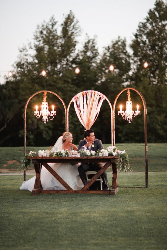 chic rustic glam wedding sweetheart table decor idea with chandeliers