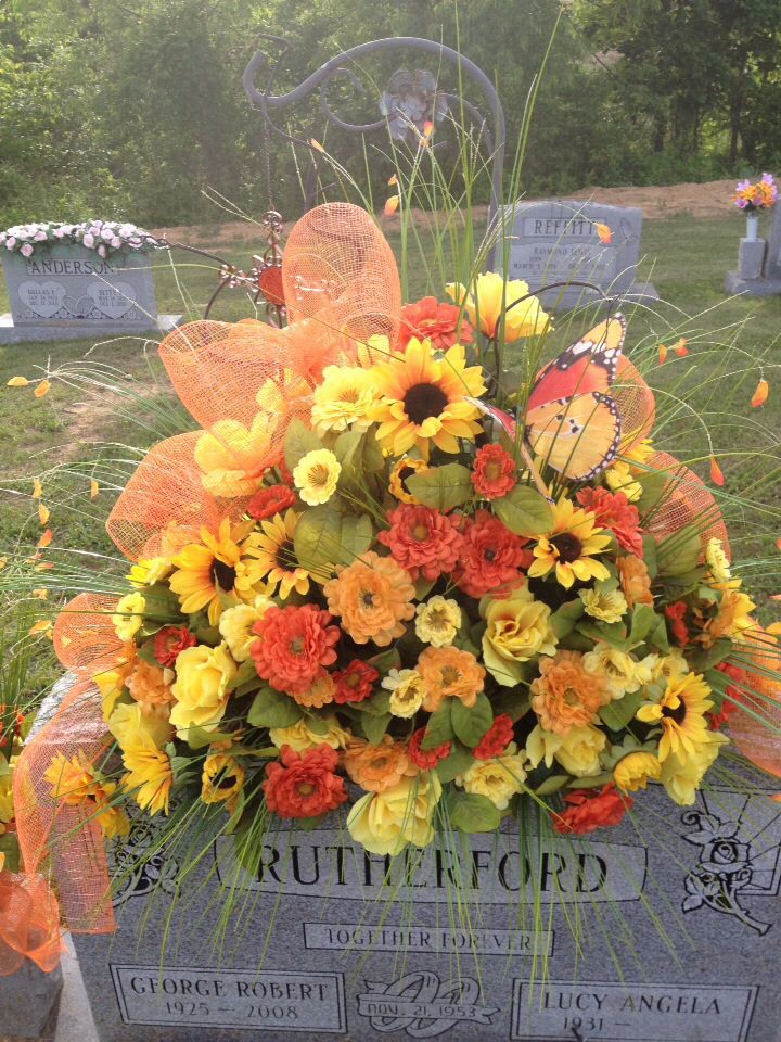 Grave saddle. Summer grave flowers made with deco mesh and fiber optic butterfly.