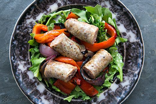 Grilled Sausage with Onions and Peppers over a bed of Arugula on Simply Recipes