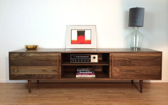 """Kasse Credenza / TV Stand 84"""" in Solid Walnut.  Too long (you need about 72"""") but I love this - and the doors slide across the different openings.  Oh, also: $2600."""
