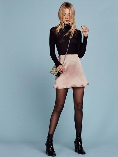 Just add tights. This is an a-line mini skirt with a center back zipper.