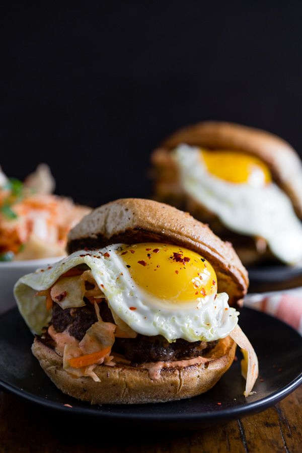 This kimchi burger is topped with a fried egg and TONS of kimchi. You'll love all the flavor that's PACKED into these burgers! Say goodbye to boring burgers