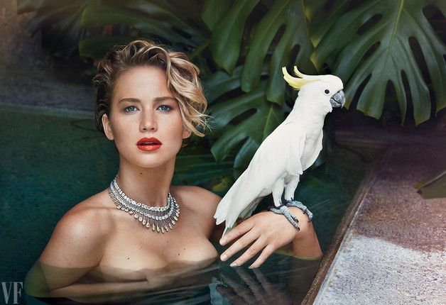 """BIRDS OF PARADISE"" (patrick demarchelier)  Jennifer Lawrence in Beverly Hills with a sulphur-crested cockatoo. ""You expect paparazzi to be annoying,"" she says. ""You don't expect them to be terrifying."""