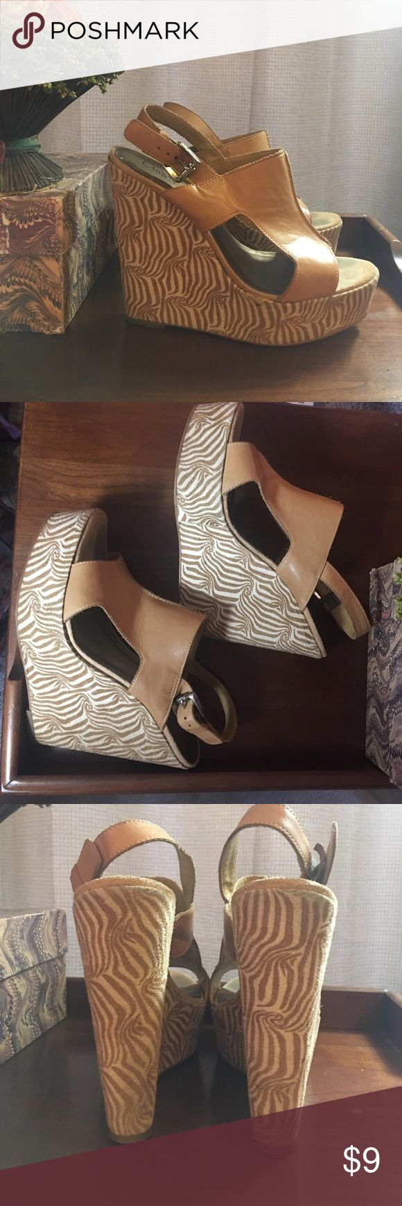 """Carlos Santana beige & cream  wedge platforms Carlos Santana beige & cream  wedge platforms. EUC. Wear is shown in pics and reflected in price. Leather upper and suede bottom. Way cute!!!!! Heels 6"""" high but not hard to walk in I promise. Remember to bundle and save 20% Carlos Santana Shoes Platforms"""
