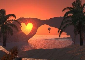 海辺の岩からハート型の夕陽が射しています。 恋人たちのためにあるような場所ですね。 ただ、残念ながら、世界のどこにあるのかは調べたけれどわかりませんでした。