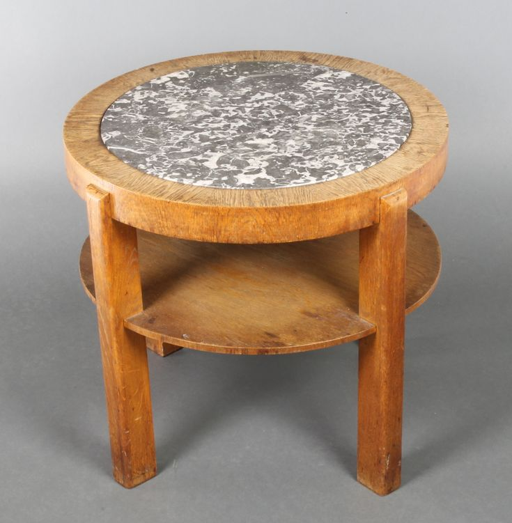 """Lot 961, An Art Deco circular oak 2 tier occasional table, the top inset a black veined marble panel 21""""h x 23"""" diam., sold for £100"""