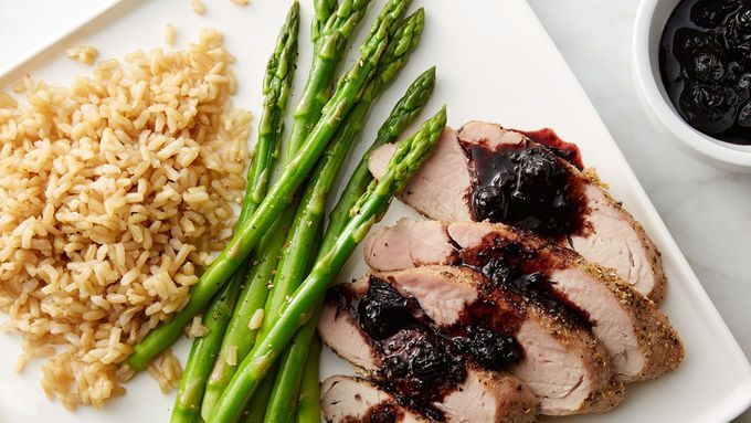Juicy, baked pork tenderloin topped with a blueberry balsamic glaze that is sure to please! It's a quick and healthy weeknight meal. Can be paired with any side, best with asparagus and brown rice.
