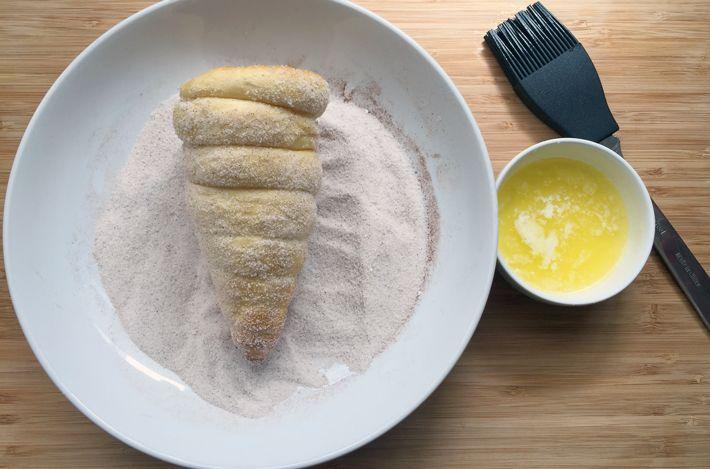 roll donut ice cream cone in cinnamon and sugar