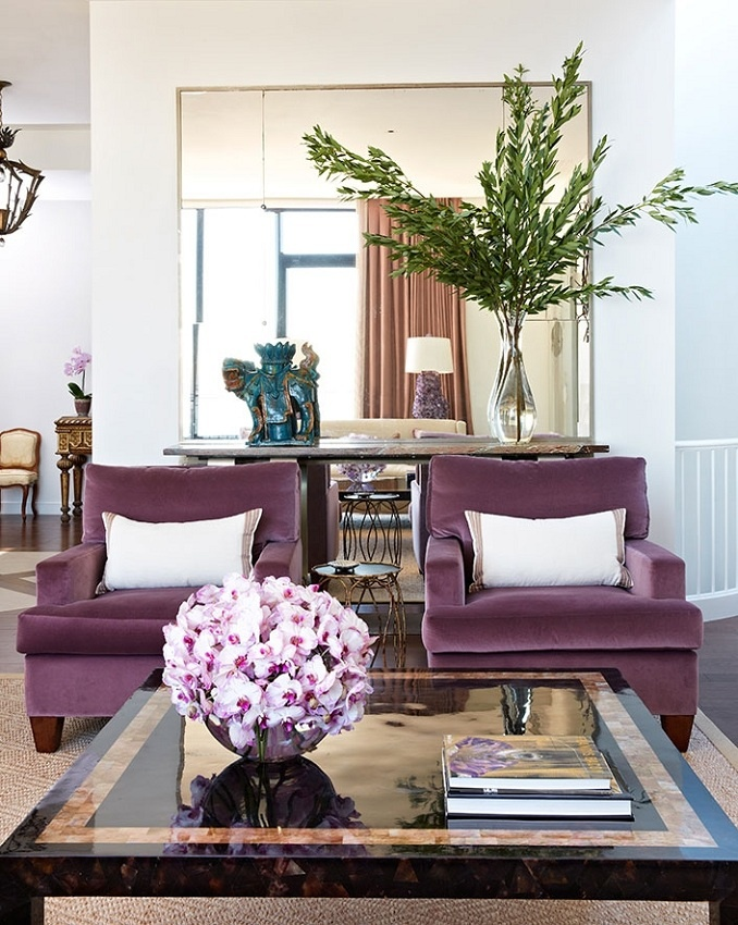 Plum velvet chairs, tortoise table