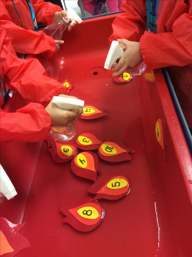 "Sensory fun with fire safety theme: we made little flames out of fun foam and wrote numbers on them. Add a little water to your sensory table so they float and give the children a spray bottle with water in it. The children can squirt the "" flame"" the number of times the number says, or squirt them in numerical order."