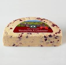 Real Yorkshire Wensleydale & Cranberries cheese. Real Yorkshire Wensleydale cheese is carefully combined with delicate, fruity succulence of pure, sweet cranberries. An original creation from the Wensleydale Creamery, the cheese displays an innovative complement of flavours, with superb visual appeal.