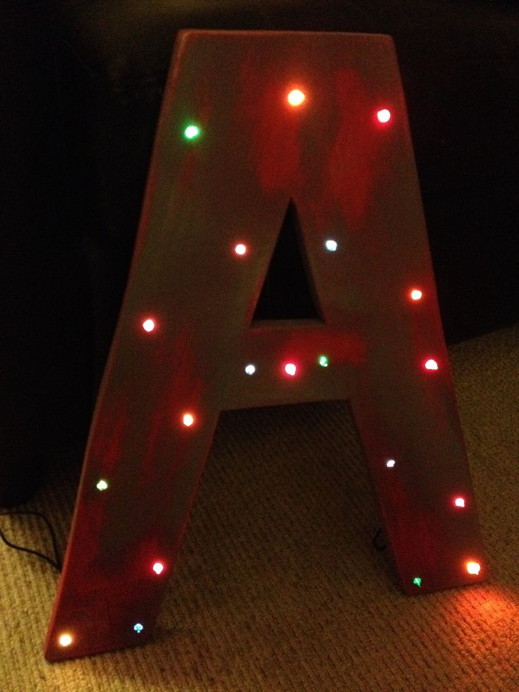 Industrial shop style letter made from recycled plywood off cuts and some fairy lights. A quick weekend project!