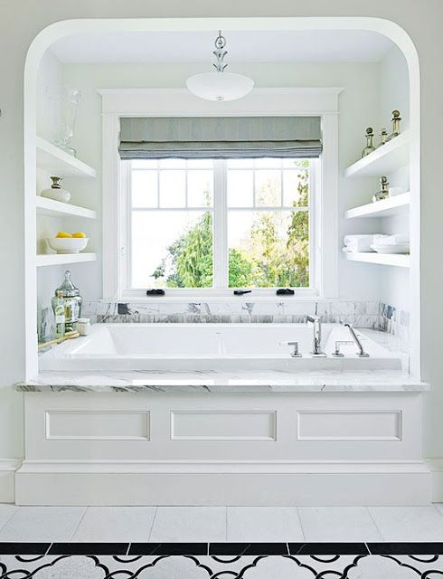 Jacuzzi tub for 2! I love the shelves and the window.