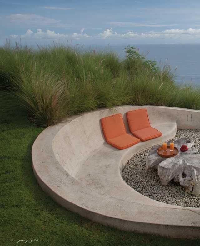 outdoor firepit and concrete bench