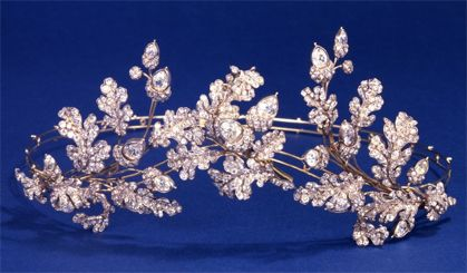 Diamond Spray Tiara, c. 1855, The British Museum. This diamond tiara combines three branches, two oak leaves and one acorn. They are set on a frame of silver and gold. The piece comes in its original case, with two tortoiseshell hair combs, the tiara frame, and brooch fittings. It was made by Hunt & Roskell, 156 New Bond Street.