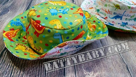Size large - Reversible bucket hat - green and white dinosaur prints, 2 hats in 1, 100% cotton, very comfortable cool for your modern kid