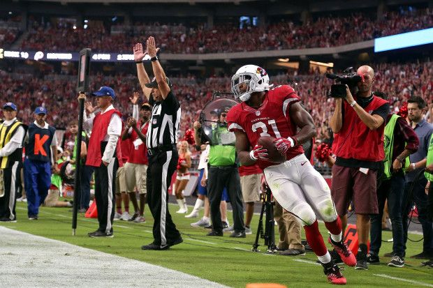 49ers vs. Cardinals:  23-20, Cardinals  -  November 13, 2016  -     Running back David Johnson #31 of the Arizona Cardinals scores a touchdown during the first quarter of the NFL football game against the San Francisco 49ers at University of Phoenix Stadium on November 13, 2016 in Glendale, Arizona.  (Photo by Chris Coduto/Getty Images)