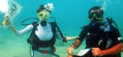 Two St. Croix residents made history by breaking the Guinness Book of World Records for the largest underwater wedding, officiated by Capt. John Macy.    #ScubaDiving