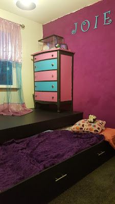 Platform with pull out bed hidden beneath. Perfect for small rooms and creating additional play space.