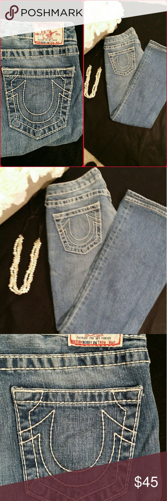 True Religion Jean light blue True Religion light blue denim  boot cut jeans with white horseshoe stitching. These are a size 28. Preowned. No rips, no tears, holes or stains. No hem wear at bottom. True Religion Jeans Boot Cut
