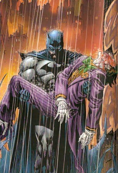 Batman holding the Joker