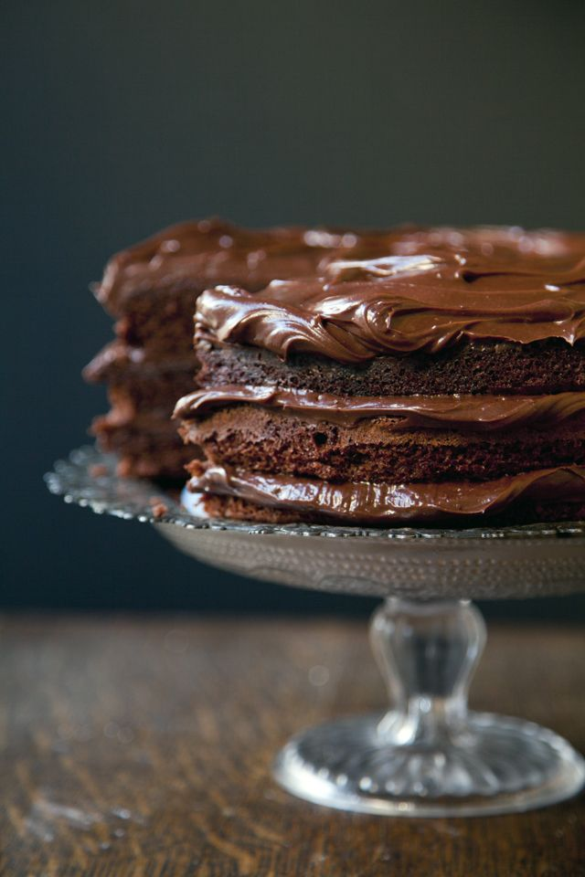 One of my favorite Swedish chocolate related recipes is the kladdkaka, a rich gooey cake which is incredibly easy to make using basic and inexpensive storecupboard ingredients.  The kladkakka recipe makes the base for this completely over the top cake which is sandwiched with a tangy cream cheese chocolate frosting.