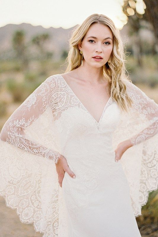 F112 Opal - From the deep neckline to the tip of the train, sheeted lace lends a mystic drama to Opal's silhouette.