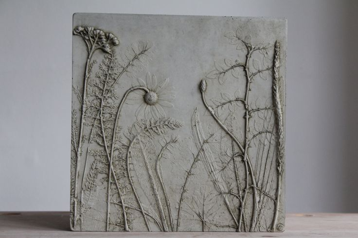 This tile is one of a series from Rachel Deins Tactile Studio. To make the tile, Rachel laid flowers and foliage on to a rolled-out slab of clay and pressed them in to transfer all their details and then carefully removed them. A wooden frame was then placed over and the plaster poured in. Once set, the clay was peeled away to reveal the 'plants' in relief. With this original piece, she made a silicon rubber mould from which this tile was cast - using Portland cement. As each tile is…