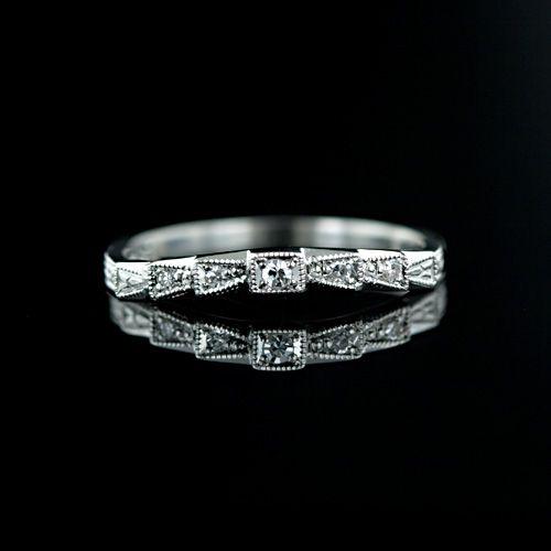 $835 slightly contoured platinum wedding band w/ five round diamonds and milgrain details