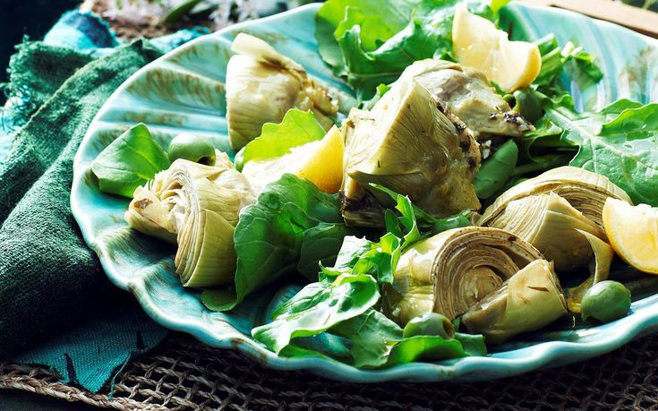 Serve up this italian classic, featuring wholesome artichoke filled with herbs, anchovies, parmesan and breadcrumbs. Dress with a green salad drizzled with lemon and olive oil to make a complete side dish. Recipe by the Australian Women's Weekly.