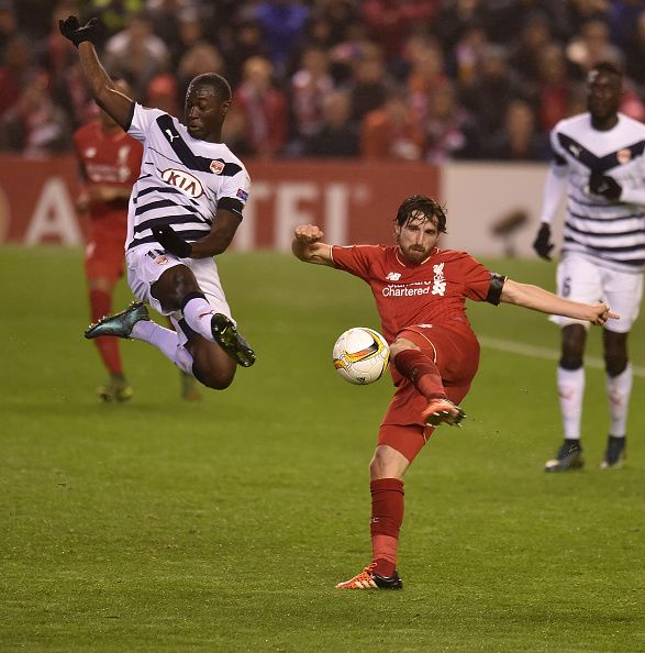 THE SUN OUT THE SUN ON SUNDAY OUT Joe Allen of Liverpool competes with Henri Saivet of FC Girondins de Bordeaux during the UEFA Europa League match...