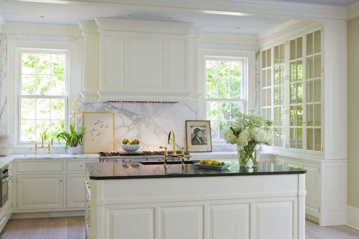 elegant cream kitchen; Calcutta marble backsplash + perimeter tops; polished black island top
