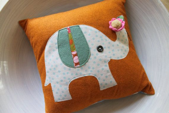 Elephant Pillow. My Grandmother always said elephants with their trunks turned up are good luck.
