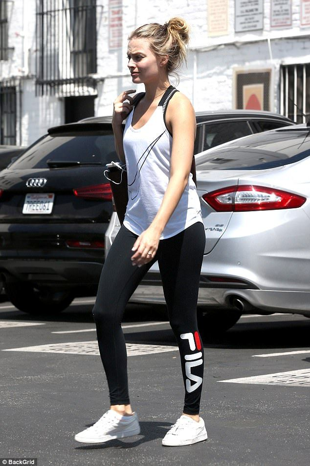 690358964a586 Fit and fab! The Wolf Of Wall Street star flaunted her trim pins in tight  black Fila leggings, partnering the look with a white Nike singlet