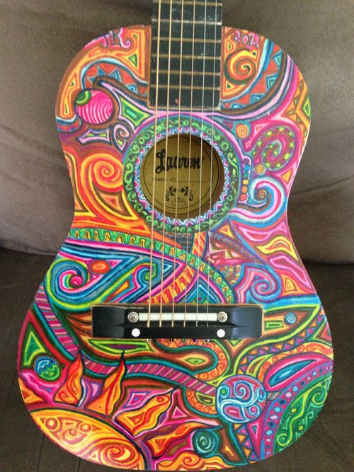 "All the colors used in the pattern looks fabulous, especially with the ""feel"" of the guitar."