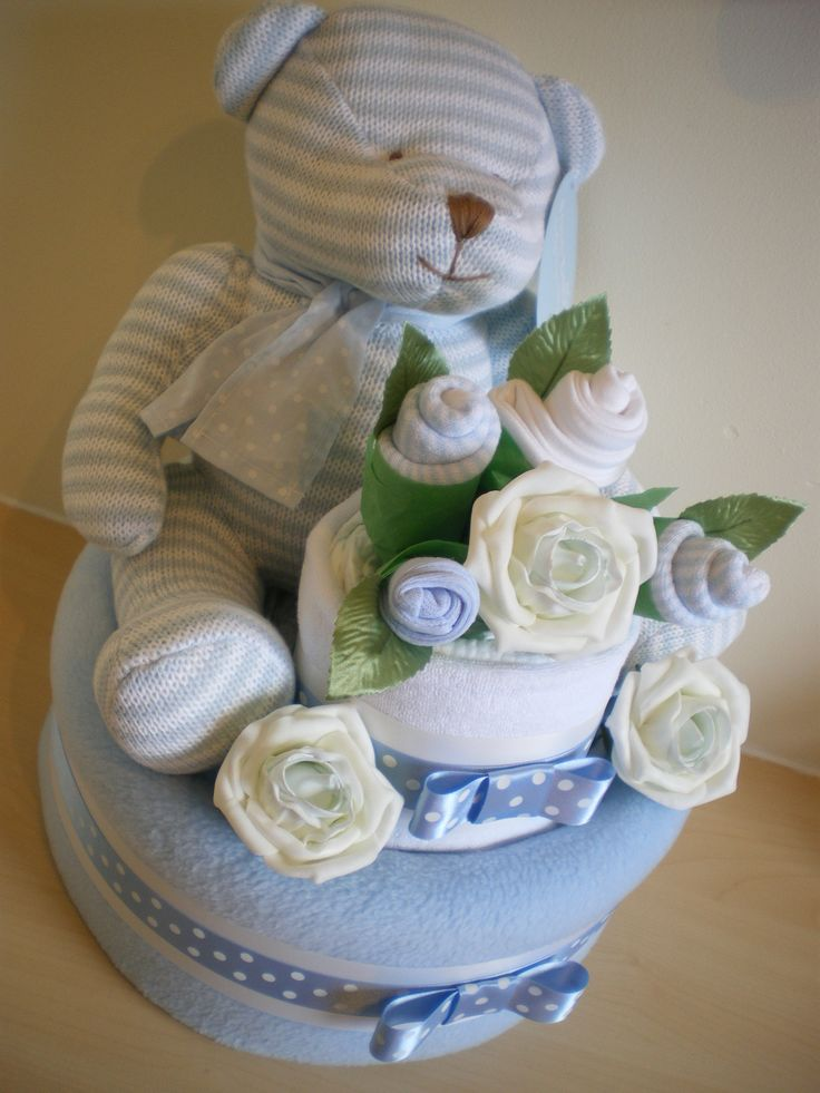 2 tier blue nappy cake with knitted bear.