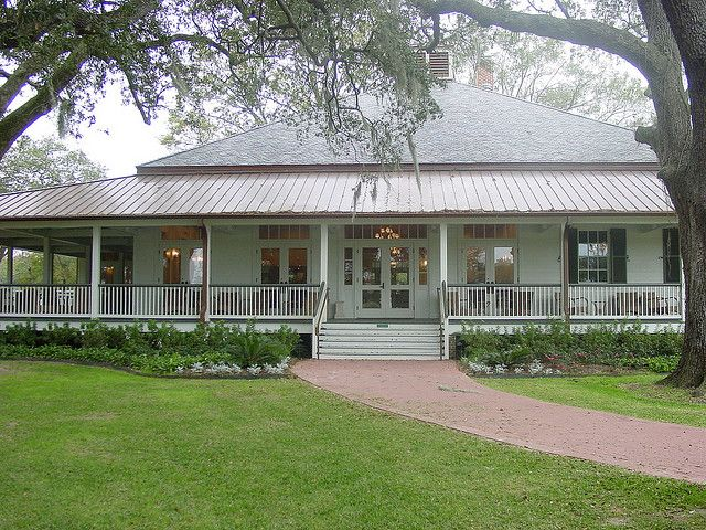 Acadian style home with huge veranda nestled in oak trees...perfect spot for our wedding!