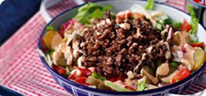 Who says you need bread to enjoy the burger experience? This clever recipe has everything but the roll: juicy beef mince, a stunningly tasty sauce and plenty of fresh salad vegetables too.