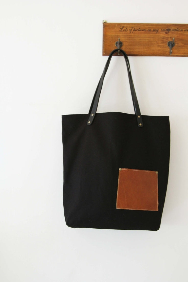 Black canvas  tote bag with Genuine Leather Handles. $62.00, via Etsy.