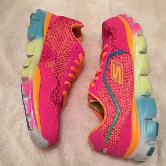 Sketchers Go Run Ride Sneakers Brand new in box. Never been worn. Neon pink mesh with a multi colored sole. Super comfortable and great for running! Sketchers also offer great support in their shoes. Size 3 in kids which is equivalent to a women's 5. Skechers Shoes Sneakers