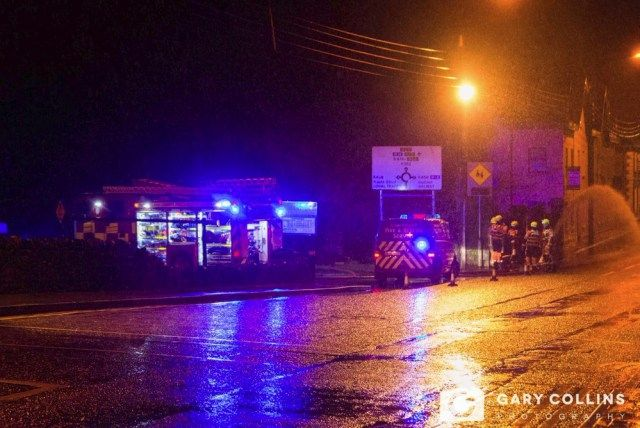Fire Service personnel pumping water from a carpark close to the junction of Bindon Street and Harmony Row in Ennis on Saturday night. Pic Gary Collins Photography