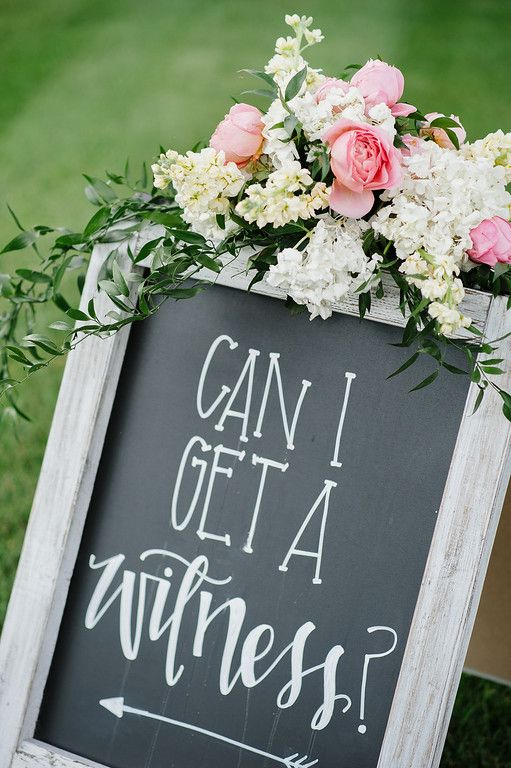 LOVE THE HANDWRITING AND THE PHRASE ON THE SIGN, AND THAT ITS FRAMED BY FLOWERS  Wedding sign humor! // Photo by Jennie Andrews #chalkboardsign #weddingideas…