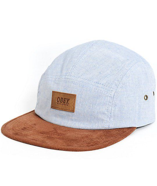 Brighten your outfits with a stylish light indigo low-profile 5 panel crown with a contrasting brown suede bill.