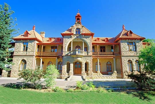 """""""Ostrich Feather Palaces""""-The history and development of Oudtshoorn, SA is connected with the growth of the ostrich feather industry as early as 1860. By the turn of the 20th century (during the Edwardian Period) the use of prime ostrich feathers in ladies' clothing was high fashion-The farming community, who had suddenly become extremely rich, vied to display their wealth and built magnificent """"palaces"""" decorated and embellished with stained glass windows, turrets and handsome cast-iron…"""
