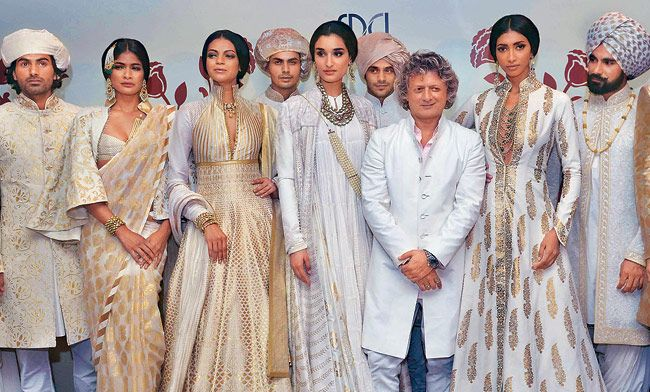 Rohit Bal at India Couture Week 2014 - models in cream and ivory gold anarkalis and saris